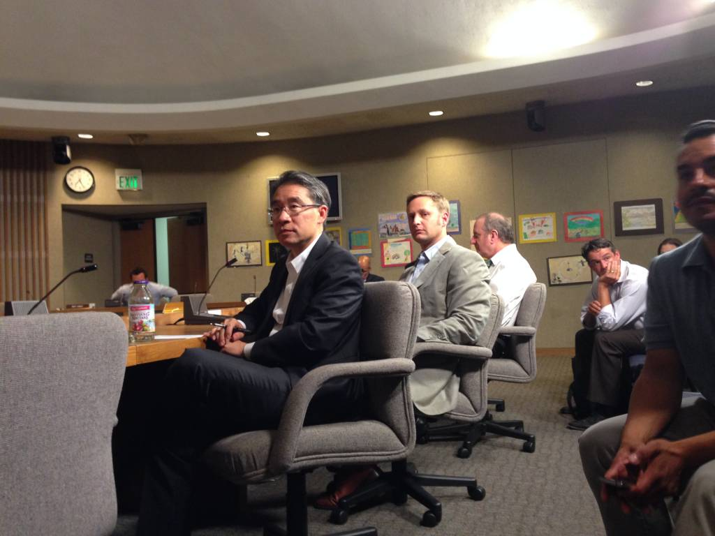 Maximum architect Leo Chow and developer Seth Mallen faced a hostile crowd at a School Board meeting.