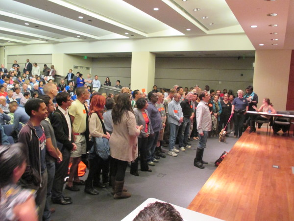 Dean Preston leads a large group of tenants appearing in favor of Prop. G