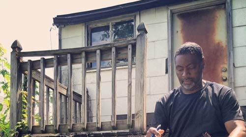 """A local organizer in a town neighboring Ferguson, Mo., shows a typical """"porch."""" (Courtesy, Silicon Valley De-Bug.)"""