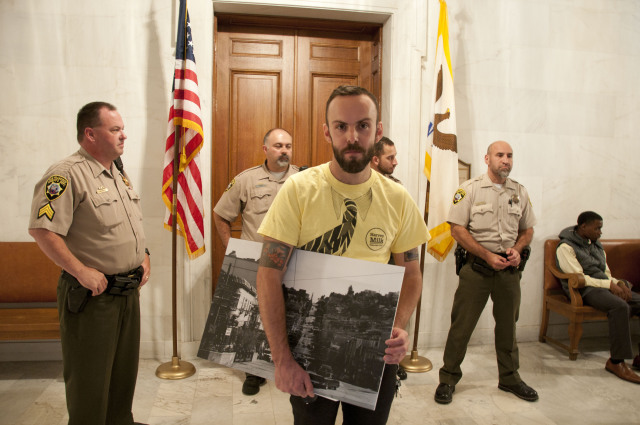 Deputies guard Mayor Lee's office as Tom Temprano leads a protest