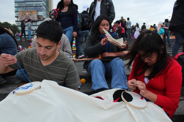 Sewing names at Day of the Dead
