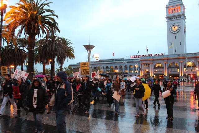 Rain does little to dampen a protest march in support of missing Mexican students