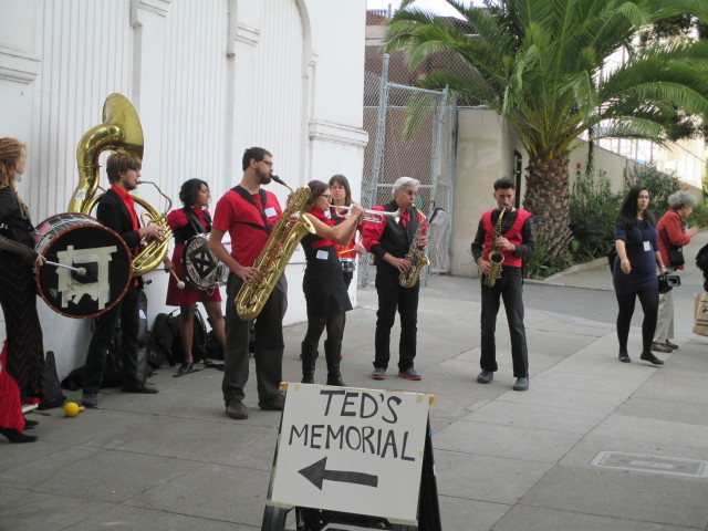 The Brass Liberation Orchestra welcomes people to the Ted Gullicksen memorial