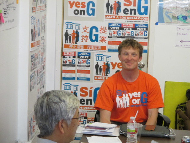 Quintin Mecke, who is running the Yes on G campaign, talks with housing activist Gen Fujioka