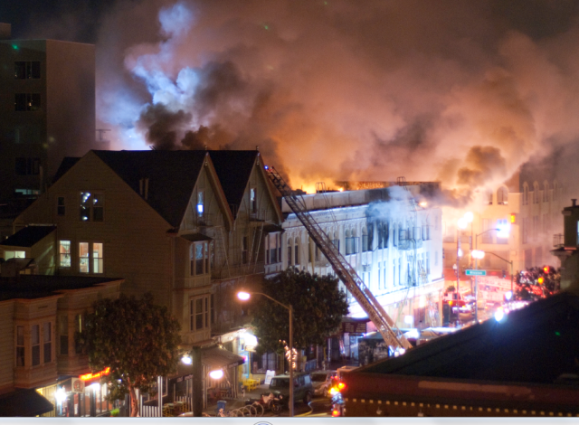 Flames shoot up from 22nd and Mission.  Photo by Fran Smith