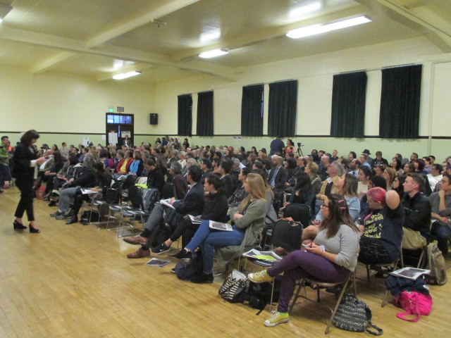 The room was packed with people who cheered when panelists talked about controlling development and evicitons
