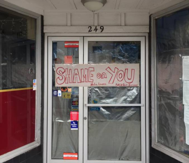 """A much-loved corner store now has a """"shame"""" poster on it, thanks to one family member. Photo from Bernalwood"""