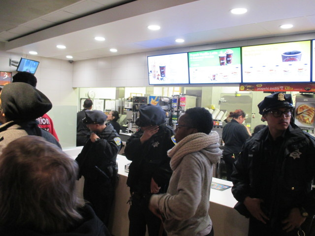 Police try to protect the counter at McDonalds, where nobody was buying anything anyway