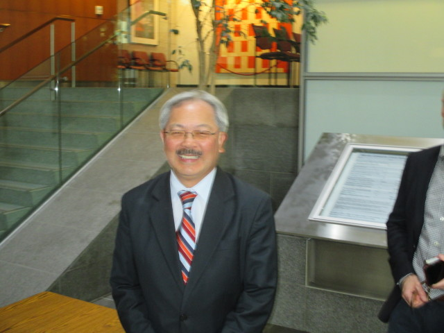 Mayor Ed Lee waits to clear security on his way to make a pitch to the DCCC at the state building