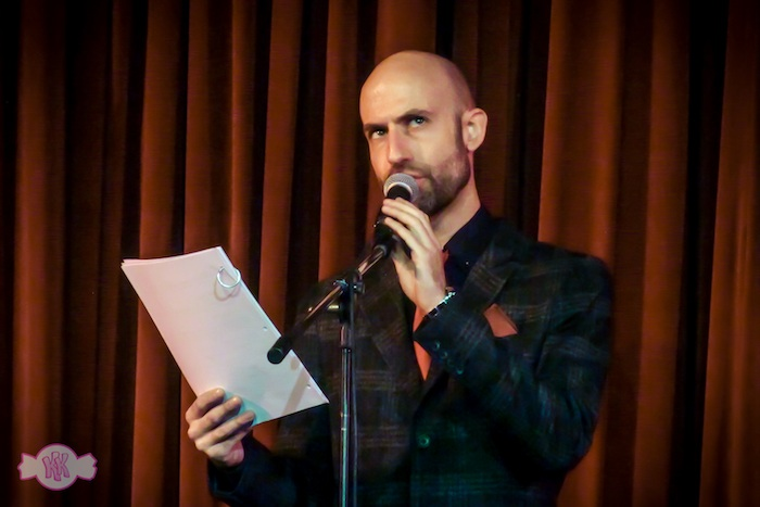 The actual Cecil, reading on stage from the last live 'Night Vale' tour, 'The Librarians'