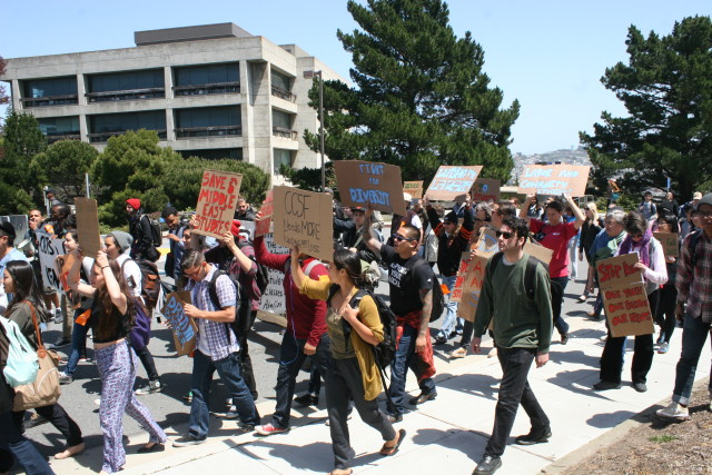 Students march to protest the continuing outside control of the school