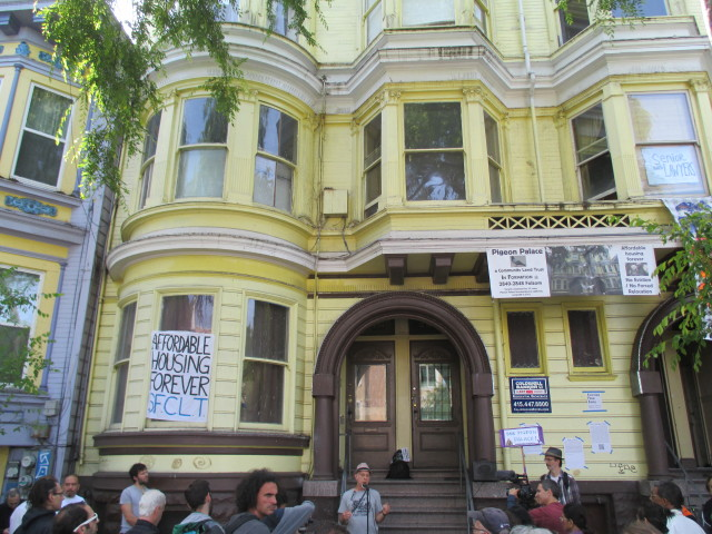 Banners adorn the Pigeon Palace at 2840 Folsom