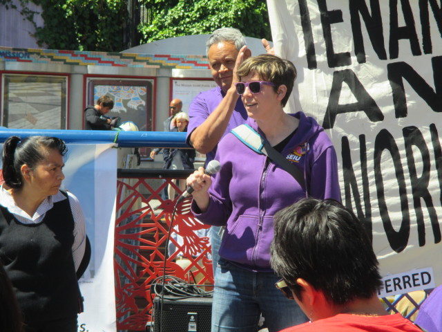 Jane Martin, an organizer with SEIU USWW, spoke to the crowd about labor and community solidarity