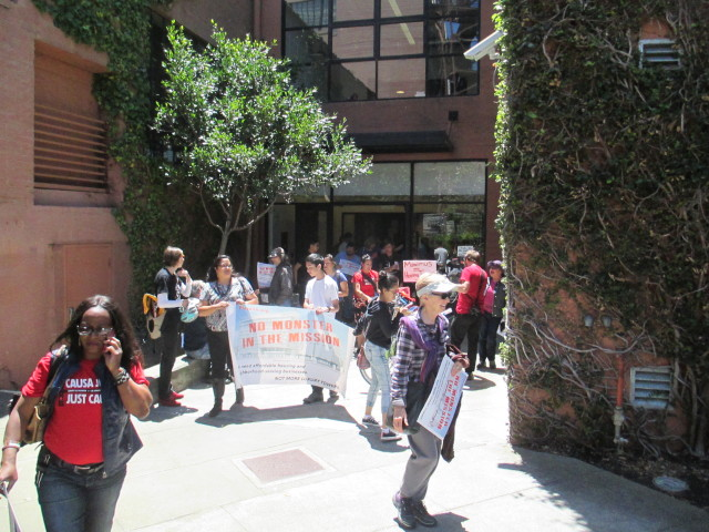 After occupying the space outside the Maximus office, the protesters peacefully marched out