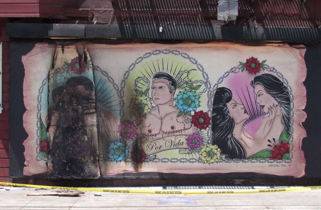 The burned mural. Photo via KQED