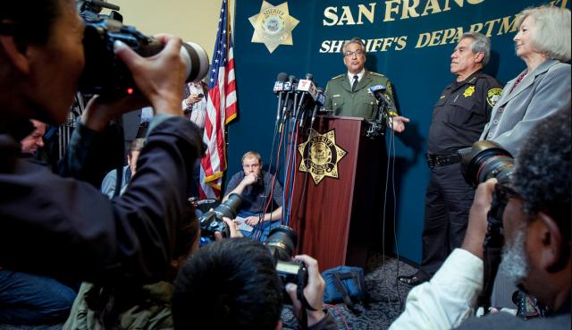 Sheriff Mirkarimi talks to a hostile press corp. Photo by Santiago Mejia