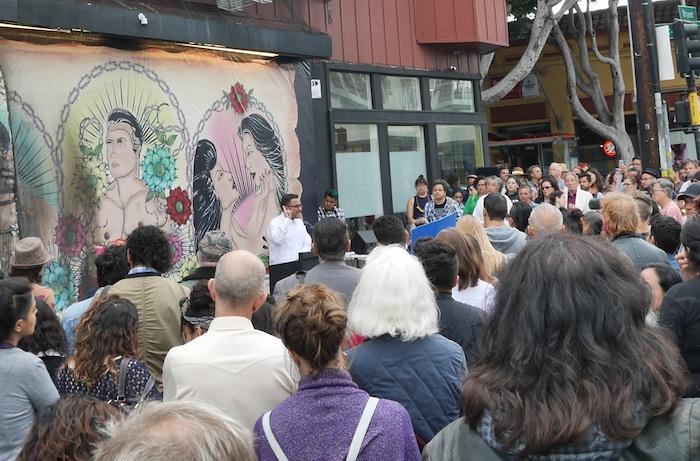 Campos addresses the crowd outside Galeria de la Raza