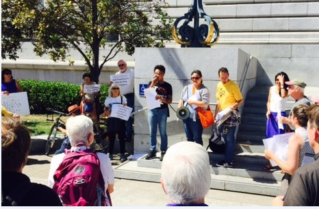 Ebony Isler, an ACCE member from Bayview, talks about the power imbalance at City Hall (Photo courtesy of ACCE)
