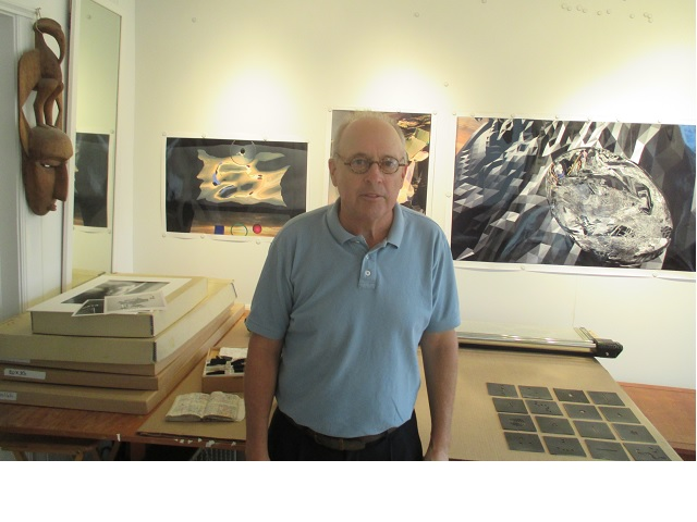 David Brenkus stands in front of some of his work