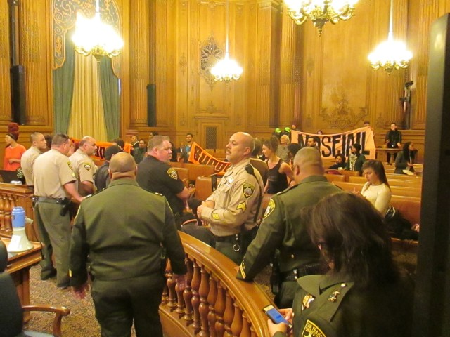 Protesters shut down the Budget and Finance Committee meeting for more than an hour