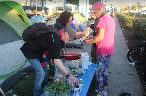 Homeless people share food: How long will they be treated as social outcasts?