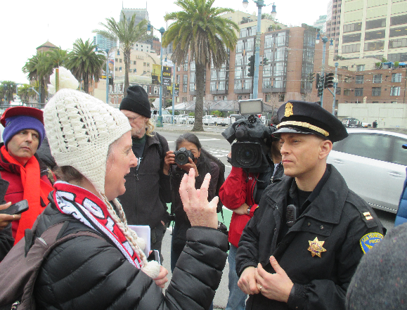 Captain David Lazar tells Jennifer Friendbach of the Coalition on Homelessness that no tents would be allowed