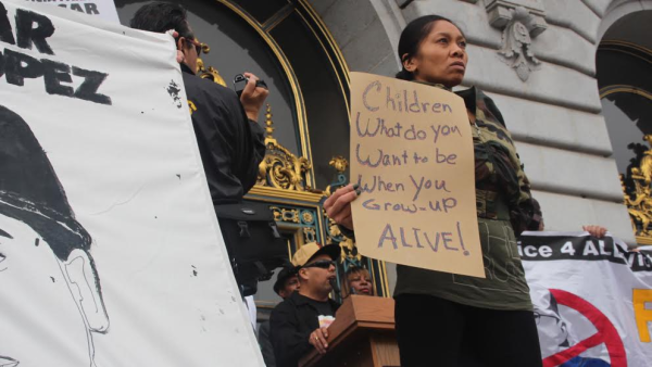 Protesters outside City Hall express outrage at the police killings of young men of color