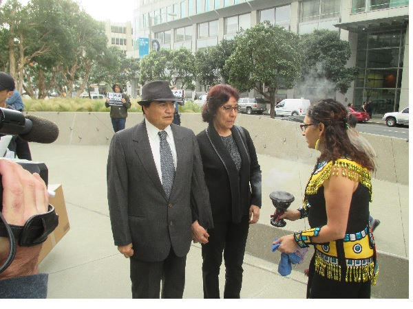 Refugio and Elvira Nieto, Alex's parents, arrive at the courthouse