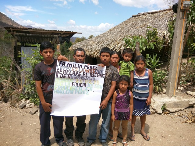 """The Perez Lopez family in Guatemala. The sign says """"We, the Perez Lopez family, demand that the assassination of our son, assassinated 2/26/2015 by the San Francisco police, be explained."""""""