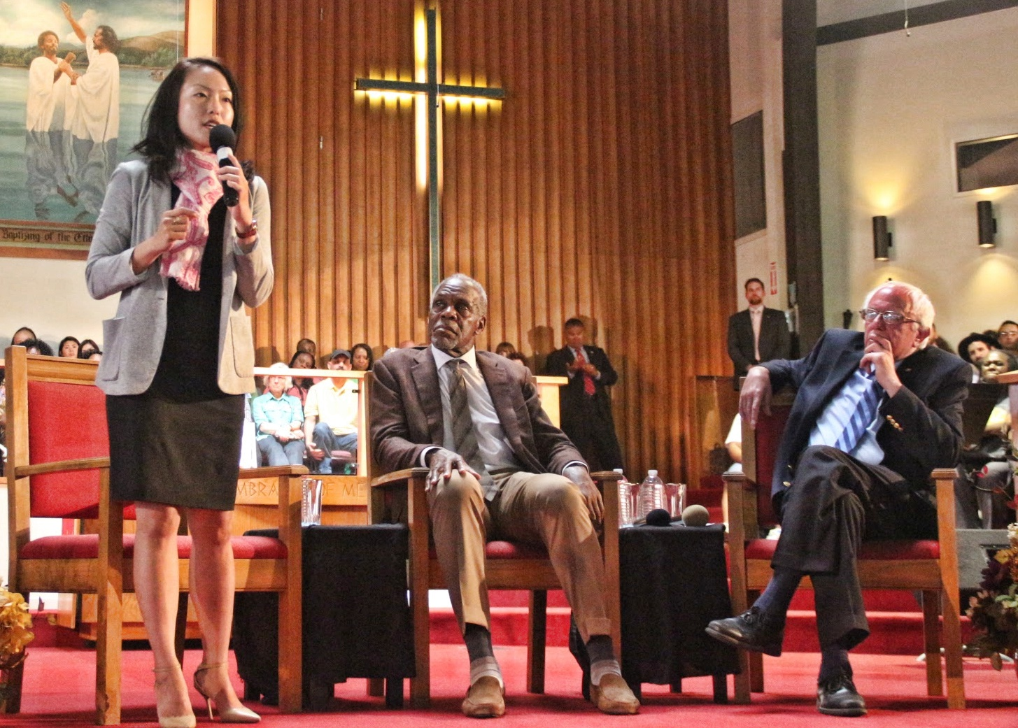 Sup Jane Kim, Danny Glover and Senator Bernie Sanders up on stage at the Allen Temple Baptist Church. Photo by Sana Saleem.