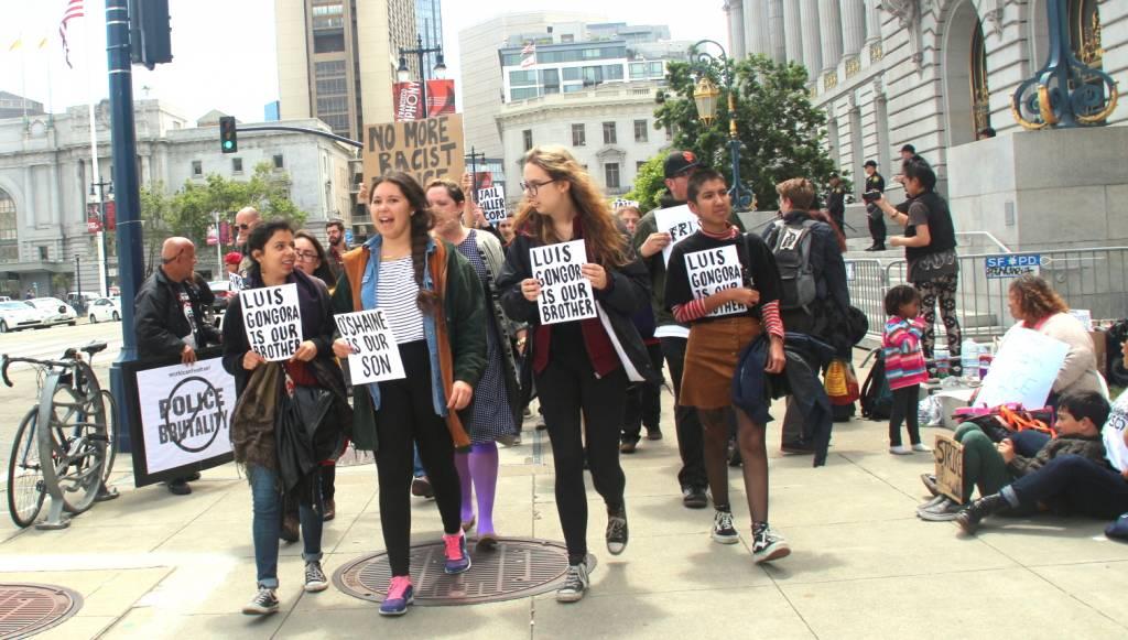 Protestors march around city hall on Monday - Photo by Sana Saleem