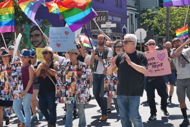 Longtime activist Cleve jones (right) led the commemorative march.