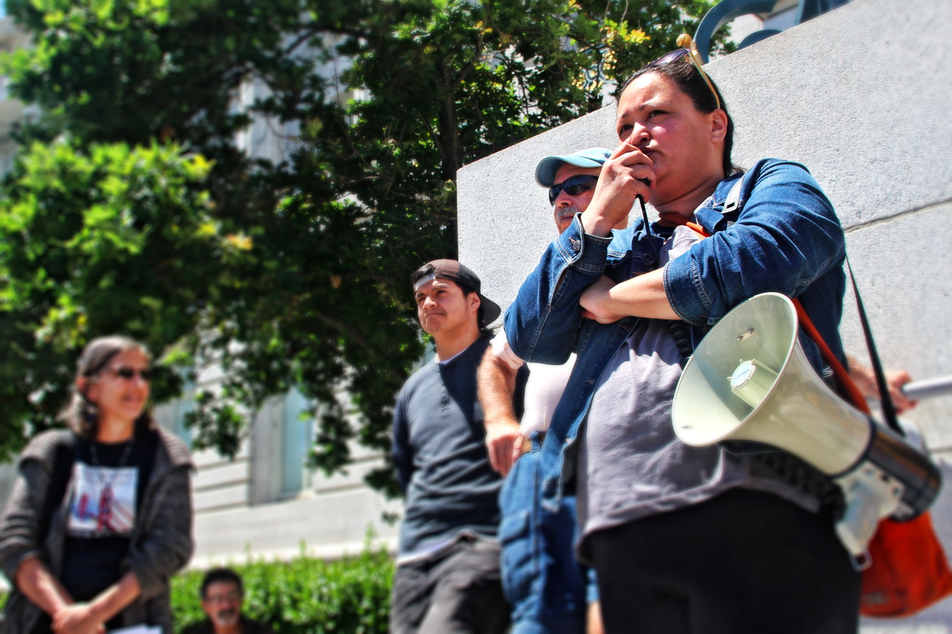 Grace Martinez, ACCE, addressed a group of supporters outside City Hall. Photo by Sana Saleem.