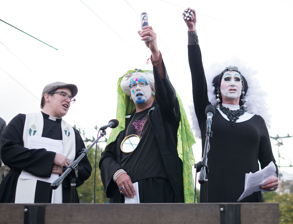 "The Sisters of Perpetual Indulgence lead the crowd in chants of ""Raise your light high!"""