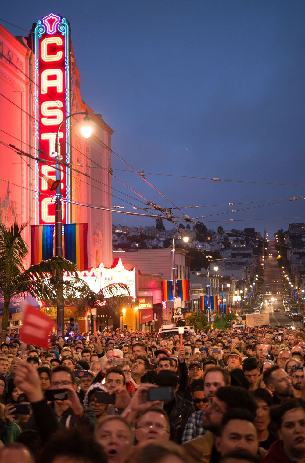 As the speakers went on and the crowd grew, darkness began to fall and the Castro filled with candlelight. Photo by David Schnur.