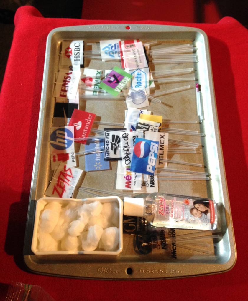A tray of corporate acupuncture supplies waits at La Pocha's Mexico City performance last week. Photo by Caitlin Donohue