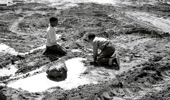 Kids play in the mud in Redevelopment-era Western Addition. Photo: SF Library