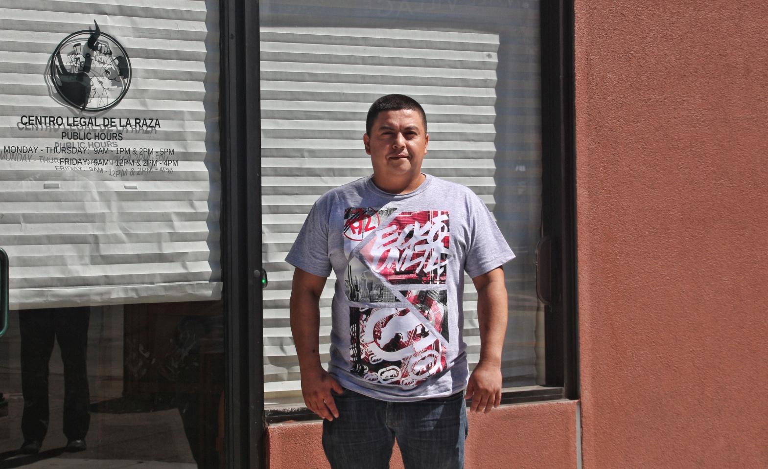 William Navarette stands infront of Centro Legal de la Raza office in Oakland. Photo by Sana Saleem