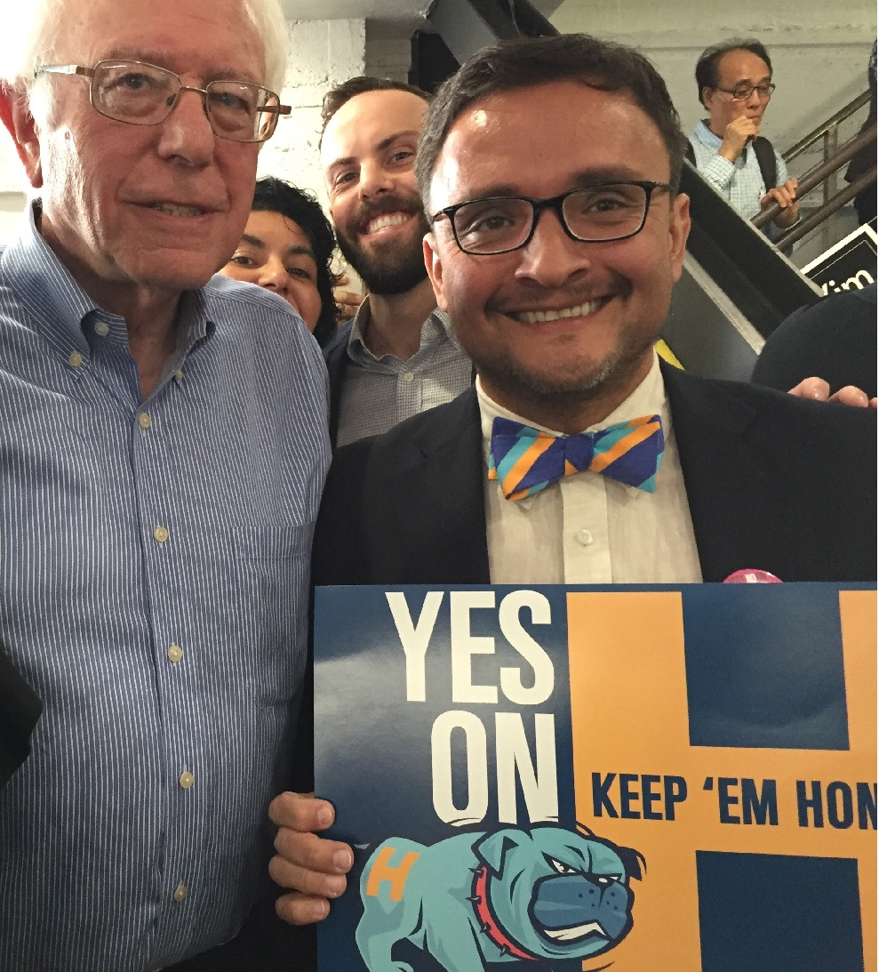 Bernie stands next to Sup. David Campos and a Yes on H sign