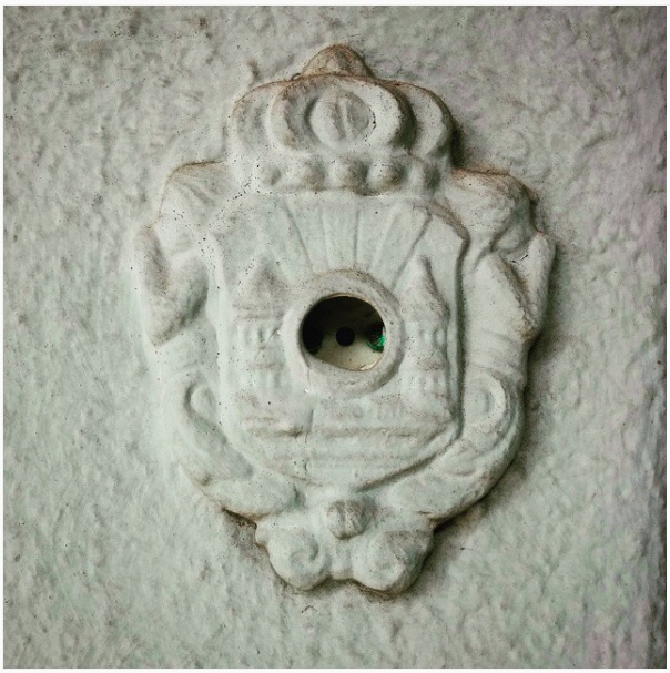 """The ornate, broken doorbell outside Weidenbaum's home. """"The vestigial doorbell. The doorbell emeritus."""""""