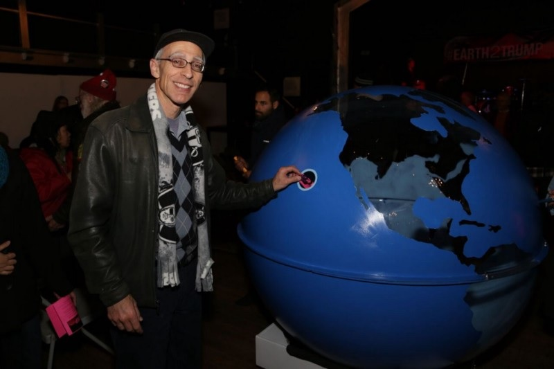 Oakland City Council Member Dan Kalb puts his message to Trump in the globe