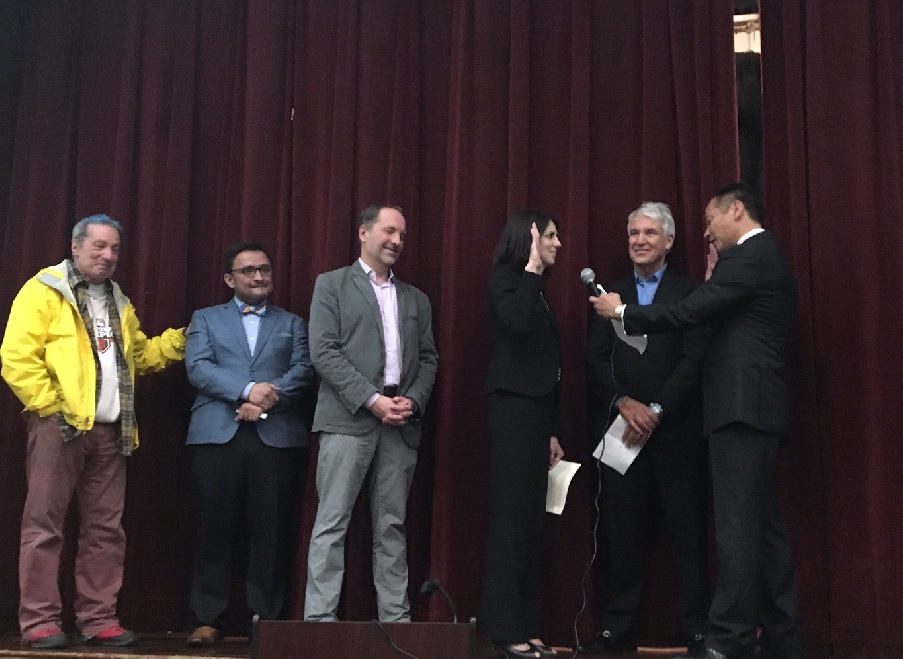 Hillary Ronen is sworn in by DA George Gascon and Public Defender Jeff Adachi, with her husband, Francisco Ugarte, and David Campos and Tom Ammiano on the stage
