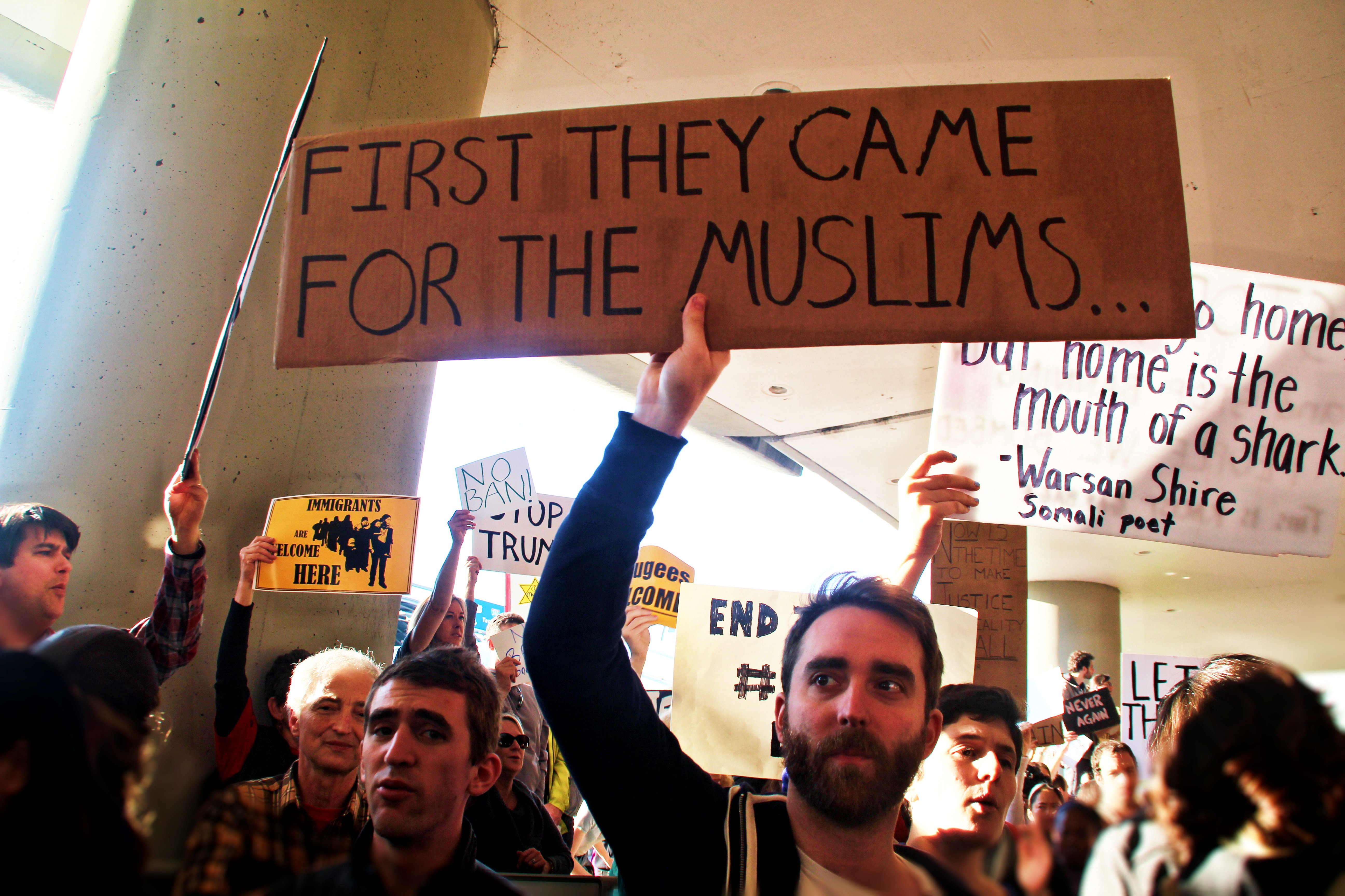 Protestors stand outside International Arrives at San Francisco International Airport to protest President Trump's Executive Order on immigration, barring individuals with legal visas from entering the United States, on Saturday 28th of January 2017.  Photo by Sana Saleem.