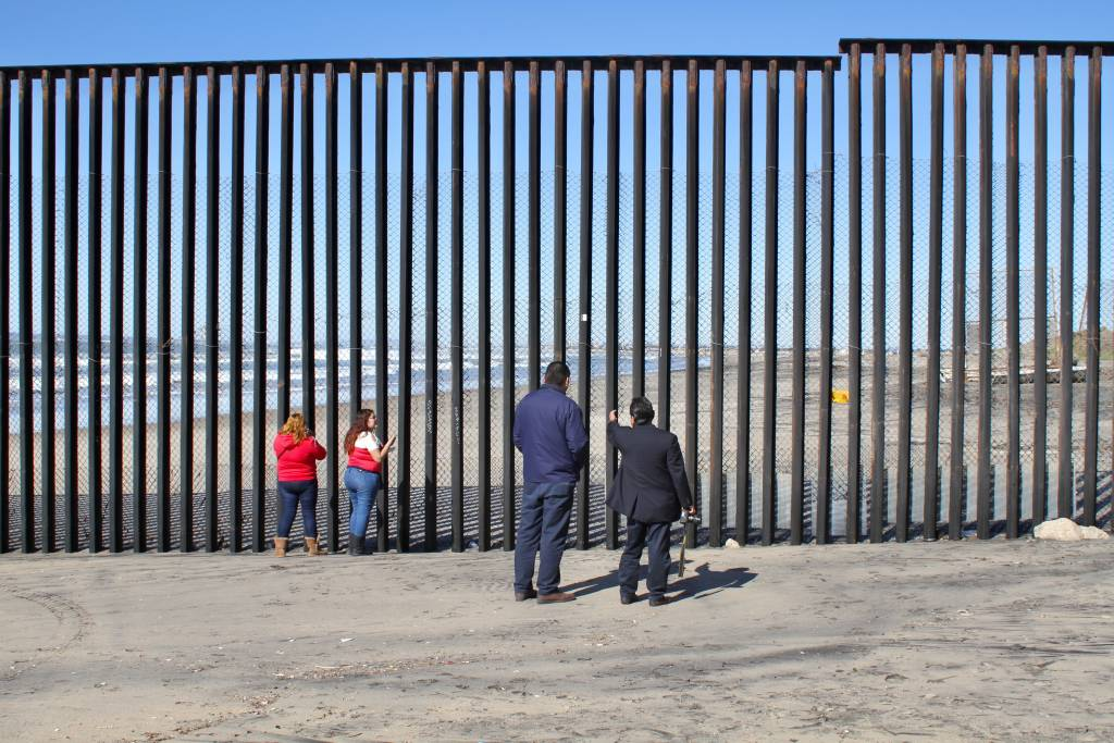 On the Tijuana side of the US-Mexico border, residents gaze across a wall that Trump says we have to build. Photo by Matthew Suarez