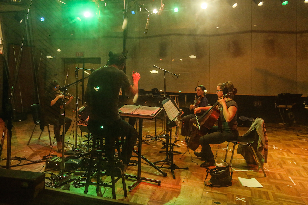 """Members of Awesome Orchestra recording """"When I'm Sixty-Four."""" Photo by Cristina Isabel Rivera."""